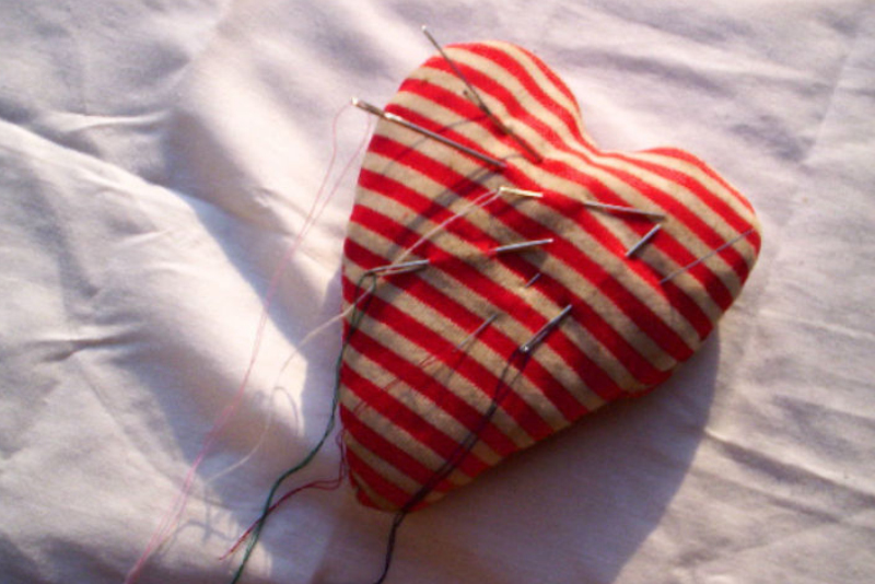 Having a baby really hurts - heart cushion with pins in